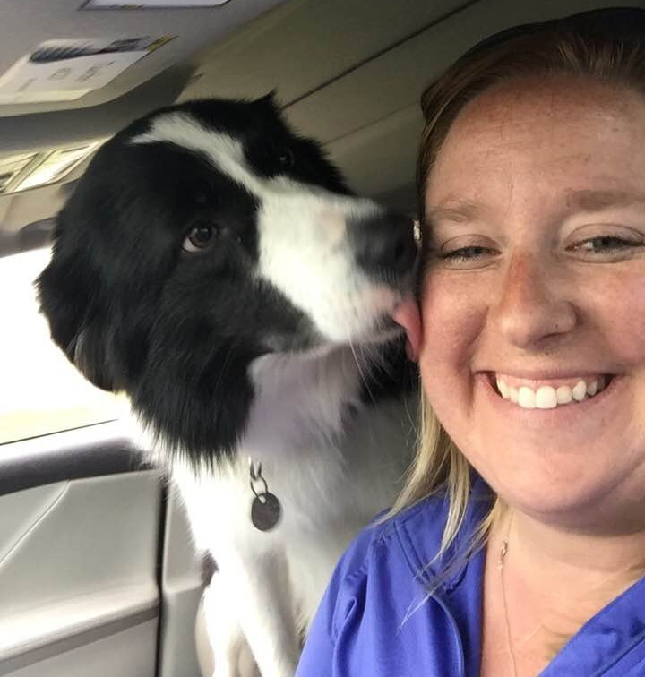 Photo of dog kissing Kylie Purcell